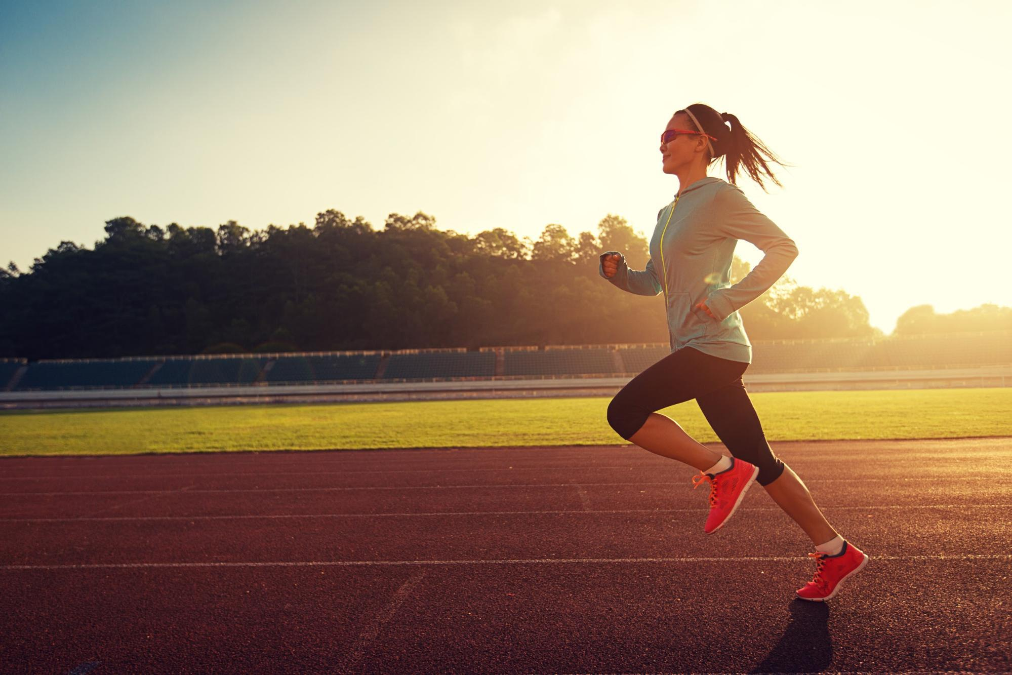 girl running on a running track