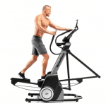 A man in athletic attire working out on the Nordictrack FS7i elliptical