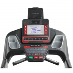 Console screen of the Sole F63 treadmill. The features includes 2 cup holders, multiple button functions, speakers, a mini fan and a tablet holder