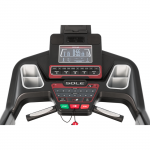 Console screen of the Sole TT8 treadmill. The features includes 2 cup holders, multiple button functions, speakers, a mini fan and a tablet holder
