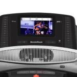 Console screen of the Nordictrack 1750 treadmill with an image of a woman conducting a fitness class. The treadmill features 2 fans, several buttons and a speaker