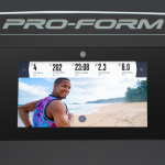 Console screen of the ProForm Smart Pro 2000 with an image of a man running on a beach The treadmill features a fan, several buttons, 2 cup holders and a speaker