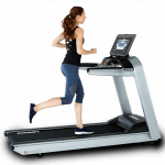 A fit woman in athletic attire running on the Landice L7 LTD Treadmill