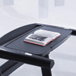 The desk of the ProForm Thinline Pro Treadmill with an opened book resting on top of it