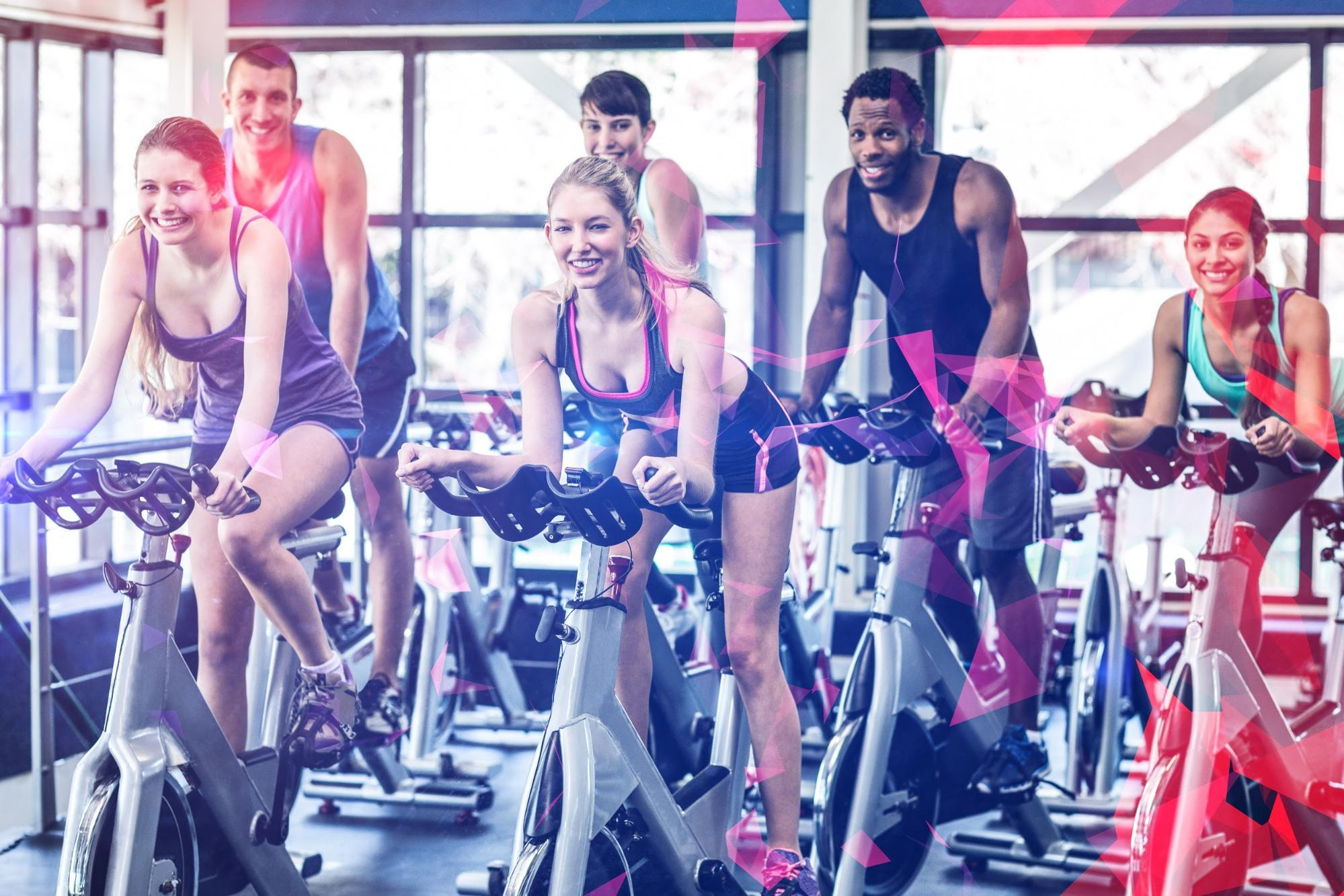 A group of people indoor cycling
