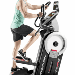 A man in athletic attire working out on the ProForm HIIT Pro Trainer Elliptical