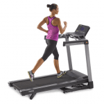 A woman in athletic attire running on the TR2000e treadmill