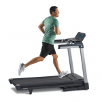 A man in athletic attire running on the TR5500i Treadmill