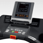This is an image of the TR8000i Console. This features 2 cup holders, a tablet holder, a digital screen, several buttons and a charging plug in